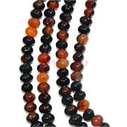 Нитка бусин из черно-оранжевого агата овальной формы 41 бусина