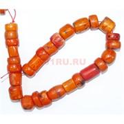 Нитка бусин разных форм из оранжевого коралла 28 шт