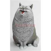 Кошка смеется из мраморной крошки